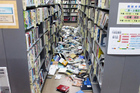 Books are scattered on the floor at a library in Iwaki, Fukushima prefecture after the strong earthquake. Photo / AP
