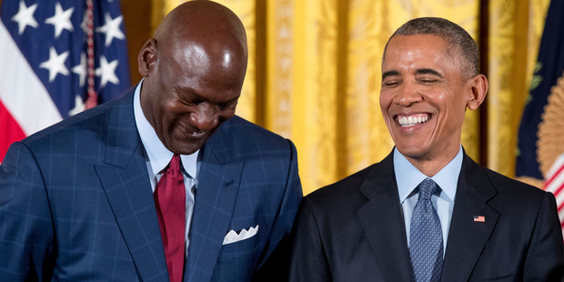 President Barack Obama, right, laughs with former NBA basketball player Michael Jordan, left, before presenting him with the Presidential Medal of Freedom. Photo / AP
