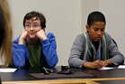Petitioners Gabe Mandell, 14, left, and Adonis Williams, 12, look on as an attorney speaks at a court hearing. Photo / AP