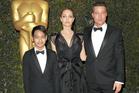 Maddox Jolie-Pitt with Mum and Dad, Angelina Jolie and Brad Pitt. Photo / AP