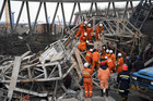 Rescue workers look for survivors after a work platform collapsed at the Fengcheng power plant in eastern China's Jiangxi Province. Photo / AP