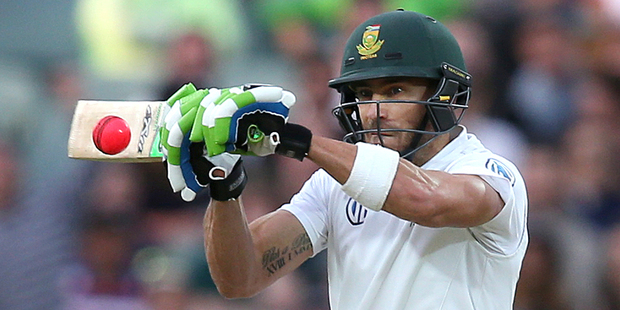 South Africa's Faf du Plessis cuts a high ball against Australia. Photo / AP