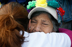 A grandmother cries during a demonstration in Mexico City today. The demonstrators mostly comprised of women travelling through Mexico to search for their missing relatives. Photo / AP