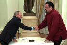 Russian President Vladimir Putin shakes hands with U.S. actor Steven Seagal in the Kremlin in Moscow. Photo / AP