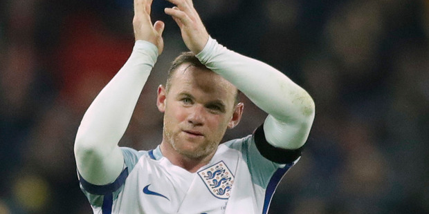 England's Wayne Rooney claps after winning the World Cup group F qualifying soccer match between England and Scotland. Photo / AP.