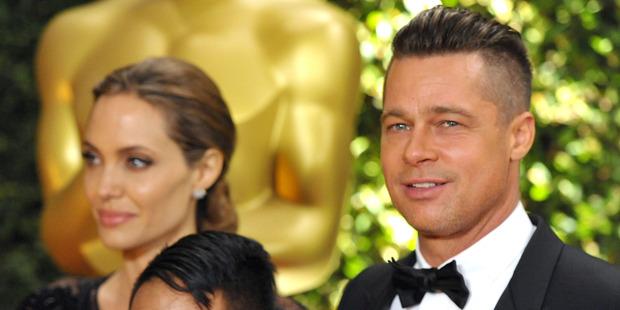 Angelina Jolie, Maddox Jolie-Pitt, and Brad Pitt. Photo / AP