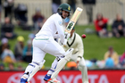 South Africa's Quinton de Kock watches his shot against Australia during their cricket test match in Hobart. Photo / AP