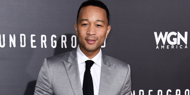 John Legend said he was 'concerned' about Kanye West's health before his hospitalization. Photo / AP