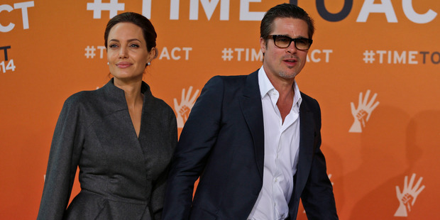 Angelina Jolie and Brad Pitt, who has been cleared by the FBI. Photo / AP