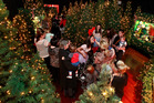 Kids and parents wait in a magic forest on the sixth floor of Smith and Caughey's before meeting Santa.