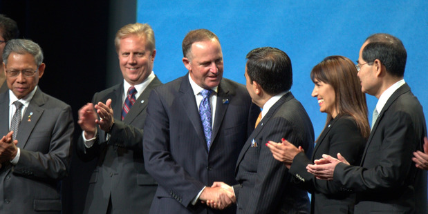 Loading Todd McClay and John Key with TPP trade ministers after signing the deal in Auckland this year. Photo/ Nick Reed