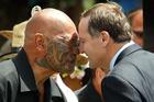New Zealand Prime Minister John Key hongis with Ngapuhi Elder Kingi Taurua, during the welcoming at Te Tii Waitangi Marae in preparation for Waitangi Day celebrations.
