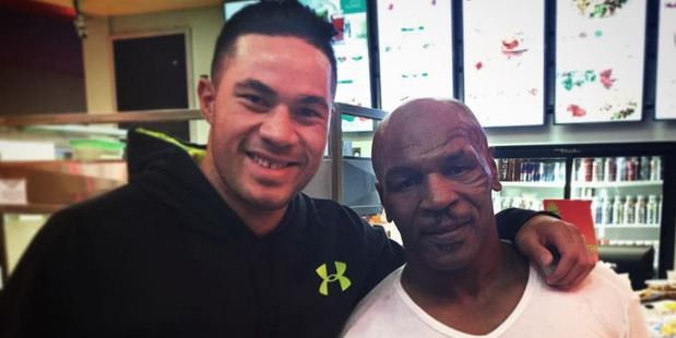 Tyson - seen here with Kiwi heavyweight Joseph Parker - says he follows boxing, but not the heavyweights. Photo / Supplied