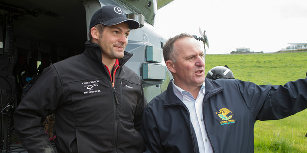 Prime Minister John Key with former All Black captain Richie McCaw during his visit to Kaikoura. Photo / Mark Mitchell