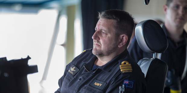 Commander Simon Rooke, Commanding Officer of the HMNZS Canterbury, on the bridge.