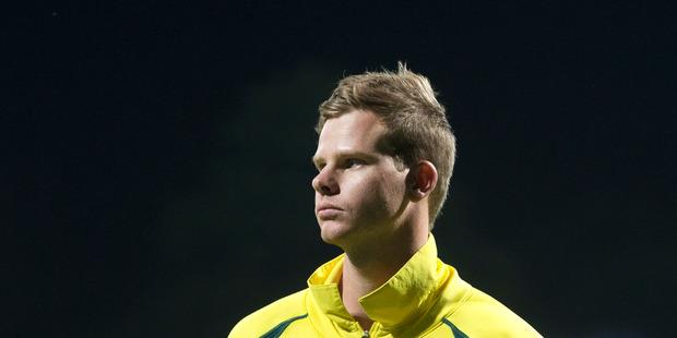 Australian captain Steve Smith looks on. Photo / Alan Gibson