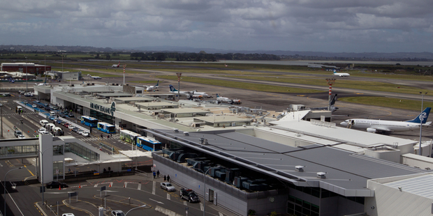 A plane is at the centre of a security scare at Auckland Airport this morning. Photo / Richard Robinson.