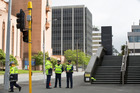 The building at 61 Molesworth Street, Wellington, which the fire service says is in danger of collapse, viewed from the police cordon on the corner of Molesworth and Hill Streets. Photo / Mark Mitchell