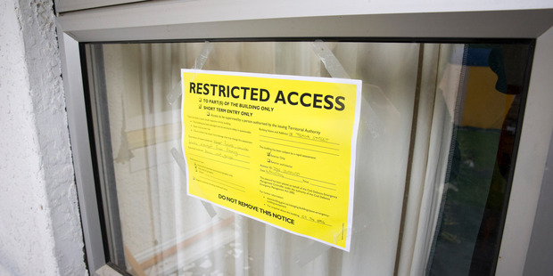 This yellow sticker shows restricted access to the house in Waiau. Photo / Mike Scott