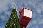 A contractor adds lights to the Christmas tree in the old City Focus last year.