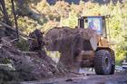 Work is underway to clear State Highway 1 around Kaikoura. Photo / Mike Scott