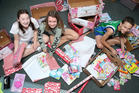 Lani Wreaks, 15, Katie Goodwin, 15, and Josh Stannard, 13, help wrap presents for the Tauranga Community Foodbank. Photo/John Borren
