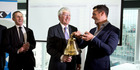 All Black Dan Carter rings bell during the sharemarket listing ceremony for Arvida Group. Photo / Dean Purcell