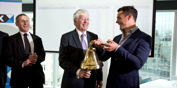 From left: NZX's Michael Ambrose, NZX chairman Peter Wilson, All Black Dan Carter ringing the bell during the sharemarket listing ceremony for Arvida Group. Photo / Dean Purcell