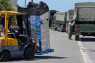 A convoy of  Army trucks carrying supplies arrives in Kaikoura earlier this week. Photo / Alan Gibson.