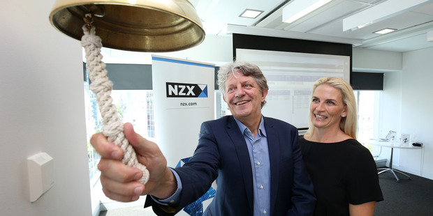 AFT Pharmaceuticals managing director Hartley Atkinson rings the bell to signal his company's sharemarket listing at the NZX in Queen St, Auckland, with wife Maree Atkinson.