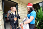 At last year's can drive in Papamoa, Summerland Crescent residents Jenny Ericksen and Summer Ericksen, 11, donated food to the foodbank. Photo/file