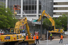 Demolition work is underway on the shopping annex attached to the nine-storey building at 61 Molesworth Street in Wellington. Photo / Mark Mitchell