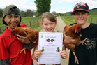 Taonga Hoeta (left), Charlie O'Hagan and Hunter Browning of Aberfeldy School are helping four-legged and feathered friends with a food drive.