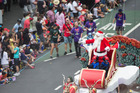 Santa will make his way down Queen St this weekend during the annual Farmers Santa Parade in Auckland. Photo / Jason Oxenham.