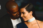 Kanye West and wife Kim Kardashian at an event in 2014. Photo/AP