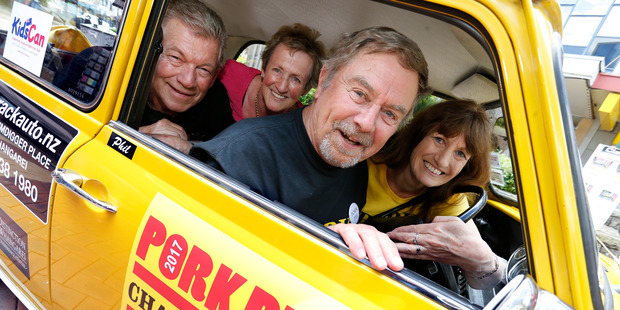 Pork Pie Charity Run supporters, from left, Peter Romer, Raewyn Messham, Phil Schultz and Margaret Povey, from Whangarei, squeezing into Phil's classic Mini. Photo / John Stone