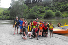 Students from Cullinane College; Hato Paora College; St Patrick's College, Kilbirnie; St Patrick's College, Silverstream; and Roncalli College cross the Whanganui River at Mosquito Point