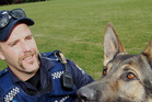 STARS: Puppy Development Officer Constable Cam Gunn with police dog Chuck who appears in the new Police dog calendar.