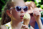 CELEBRATE: Patrons, like 8-year-old Olivia McLean, enjoyed around 2500 ice-creams at Rush Munro's 90 year celebration. PHOTO/PAUL TAYLOR.