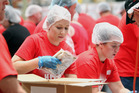 Good cause: Lee-Anne Levett (left) and Kim Brenchley were two of the volunteers assembling 100,000 meals for Salvation Army to distribute in NZ and hopefully Fiji. Photo/Paul Taylor.