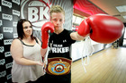 KIWI CORNER: Amateur boxer Sam Nicol gets a feel for the WBO heavyweight boxing belt at Burger King Hastings yesterday with the help of mother Andrea.  PHOTO/Warren Buckland