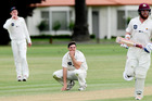 CD bowler Ryan McCone (squatting) can't believe how close he came to getting out an ND batsman. PHOTO/Warren Buckland