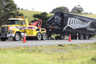 A tow truck prepares to remove this Mainfreight truck that collided with the trailer of a fully laden log truck on State Highway 1 in Mata. Photo / Imran Ali
