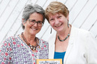 Agnes Hermans (left) and Valerie Moss-Green with hot-off-the-press True Tales of Onerahi. Photo / Michael Cunningham