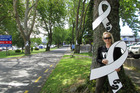 WHITE RIBBON: Penny Rollo pictured with the tree artwork by the Hospital. PHOTO/SUPPLIED