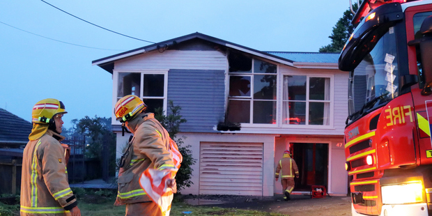 A suspicious house fire being investigated by police in West Auckland is the same address where a woman was stabbed to death last month. Photo / SNPA
