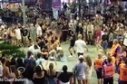 A large brawl erupted among schoolies at Surfer's Paradise when Australians mockingly danced around a group of New Zealanders performing a haka
