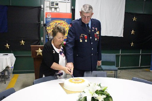 Dave and Pat McKenzie cut the cake they've worked hard for for 50 years.
