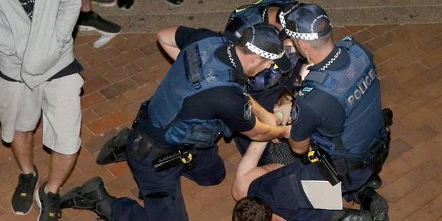 Police make arrests last night. Photo / Mike Batterham / News Corp Australia