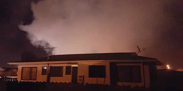 Smoke rising into the sky from 400m away from the factory. Photo / Sarah Ganly